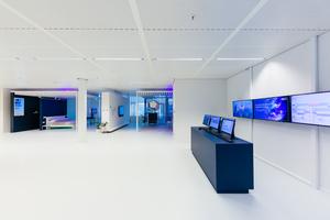 """Station 1: """"Kontrollzentrum"""": An der ersten Station befindet sich das """"Kontrollzentrum"""", an dem ein Einblick in die Nutzung von Künstlicher Intelligenz und in die zukünftige automatisierte Auswertung von Nutzerverhalten und von Betriebsstatistiken erfolgt"""
