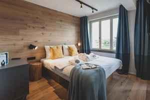 In den komfortablen Zimmern sind der Charme einer Berghütte und die Gemütlichkeit des Küstenflairs miteinander kombiniert