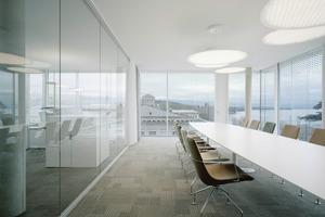 Der Hauptsitz der WTO mit seinen gläsernen Fassaden in Genf. Im engen Austausch mit der WTO wurde die Bürolandschaft an die Tätigkeitsfelder der einzelnen Abteilungen angepasst